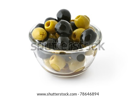 Green and black olives in a glass bowl isolated on white with clipping path