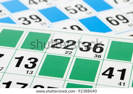 Green and blue Bingo cards and number thirteen