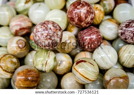 Green and brown balls made from onyx stone.