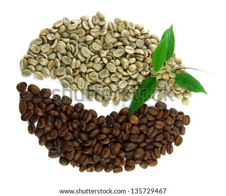 Green and brown coffee beans isolated on white