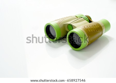 Green and Brown color binocular toy isolated on white background #658927546