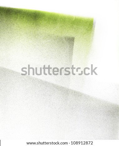 Green and grey artwork gradient background.