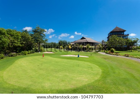 Green and holes in front of Golf clubhouse in Bali, Indonesia