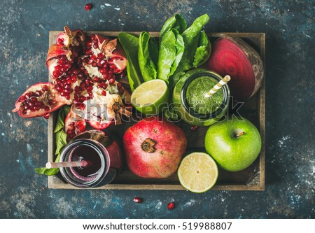Shutterstock Green and purple fresh juices or smoothies with fruit, greens, vegetables in wooden tray, top view, selective focus. Detox, dieting, clean eating, vegetarian, vegan, fitness, healthy lifestyle concept