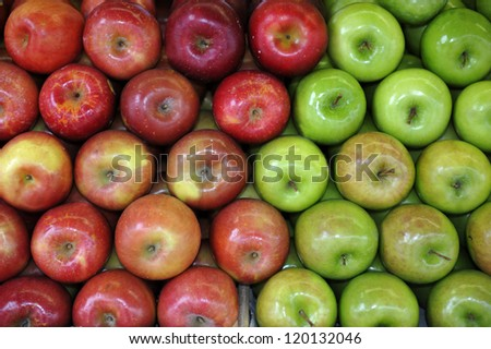 Green and red apples at the greengrocer