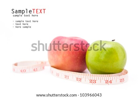 Green and red apples with measuring tape, isolate on white background
