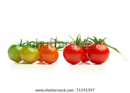 green and red cherry tomatoes isolated on white