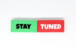 green and red cubes with the words Stay tuned