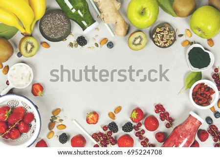 Green and red fresh juices or smoothies with fruits, vegetables on grey background, top view, selective focus. Detox, dieting, clean eating, vegetarian, vegan, fitness, healthy lifestyle concept