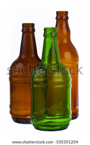 green and two brown bottles of beer on white background