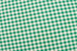 Green and white checkered fabric, traditional picnic tablecloth
