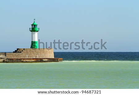 Green and white lighthouse on the Island of Rügen in Germany