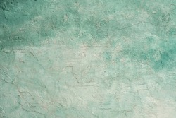 green and white painted grungy rough stucco wall background