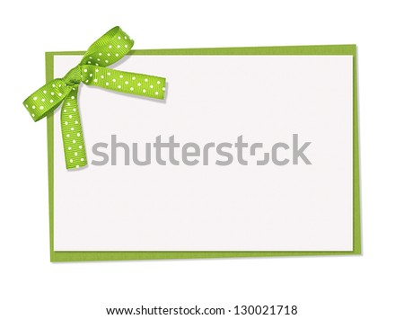 green and white polka dot card, ribbon and bow, isolated over white background