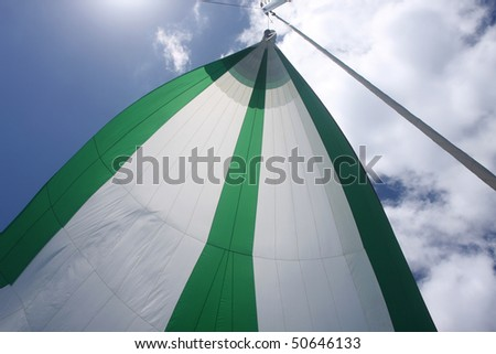 Green and white spinnaker on sailboat