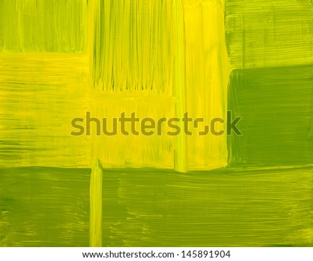 Green and yellow abstract painting on canvas