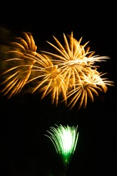 Green and yellow fireworks in summer