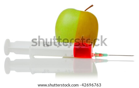 green apple and a syringe with red fluid