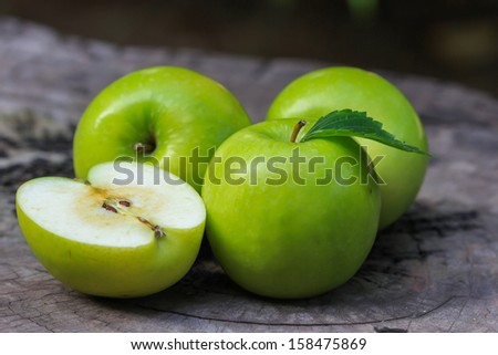 Green apple and half with seeds Green apple.