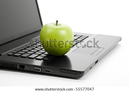 Green apple and laptop close up