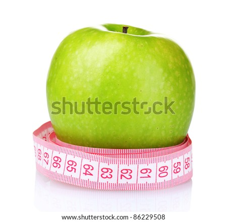 green apple and measuring tape isolated on white