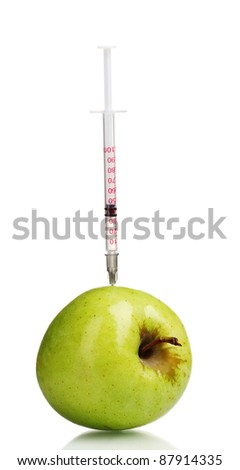 green apple and syringe isolated on white