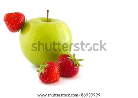 Green apple and three red strawberries isolated on white background