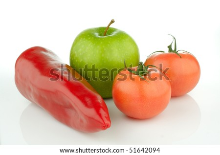 Green apple and tomato on a white background.