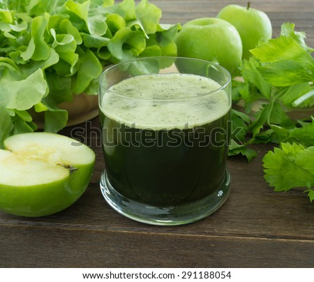 green apple and vegetable smoothie  for health.
