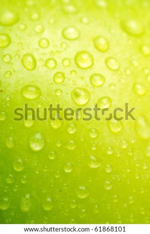 Green apple close-up with water drops
