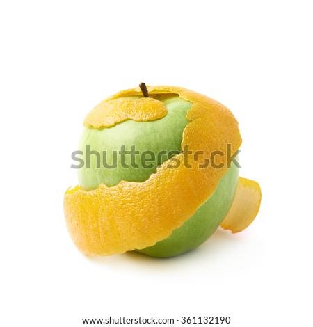 Green apple covered with orange peel