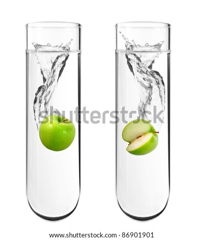 Green apple dropped in chemical test tube, Biotechnology, Genetically Modified Organisms