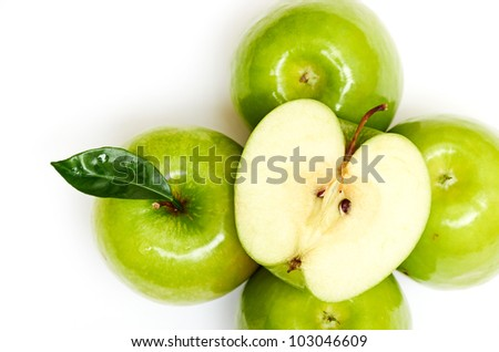 Green apple fruits and half of apple and green leaves isolated
