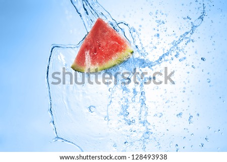 Green apple in splash of water isolated