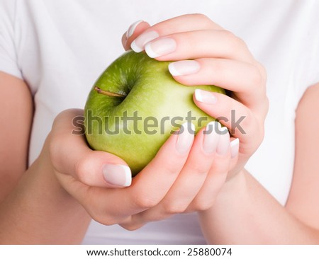 Green apple in woman's hands