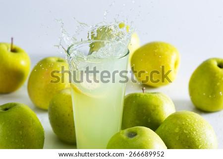 Green apple juice splash