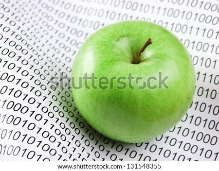 green apple on a binary code - stock photo