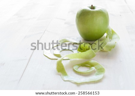 Green apple on rustic white table Photo stock ©