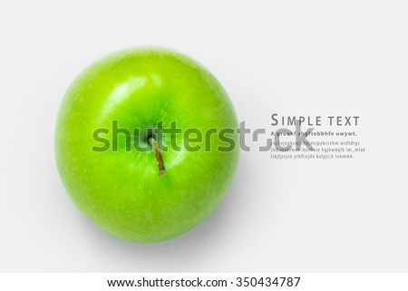 Green apple on white background Top view