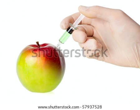 Green apple receiving an injection for rapid ripening