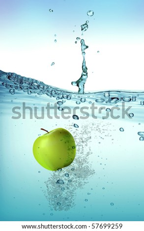 Green apple splashing into water