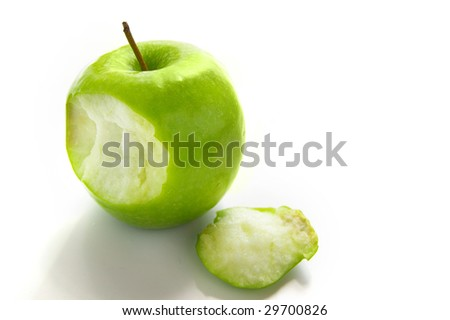 green apple with a bite taken out, from above