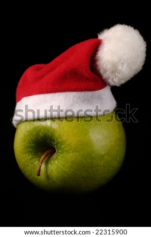 Green apple with a christmas hat