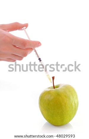 Green apple with a syringe on a white background