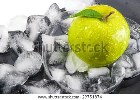 Green apple with leaf and the broken ice