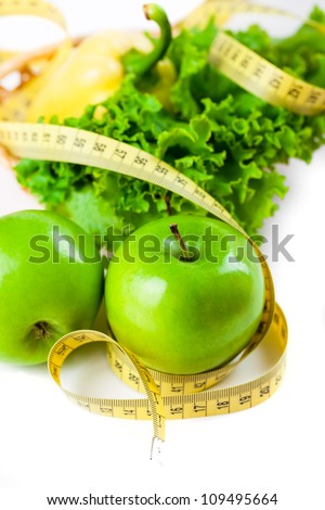 green apple with measure tape