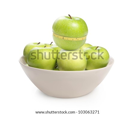 Green apple with measurement isolated on white background