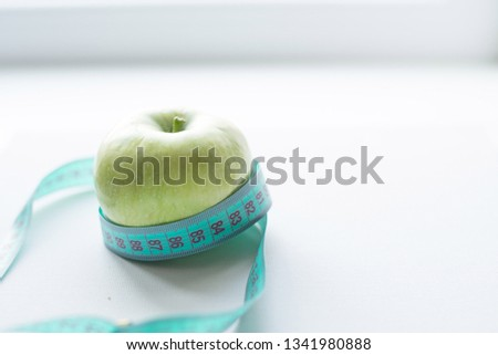 Green apple with measuring tape isolated on white background.Diet concept.place for text. copy space. #1341980888