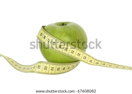 green apple with tape isolated on white background