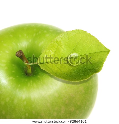Green apple with water drop isolated
